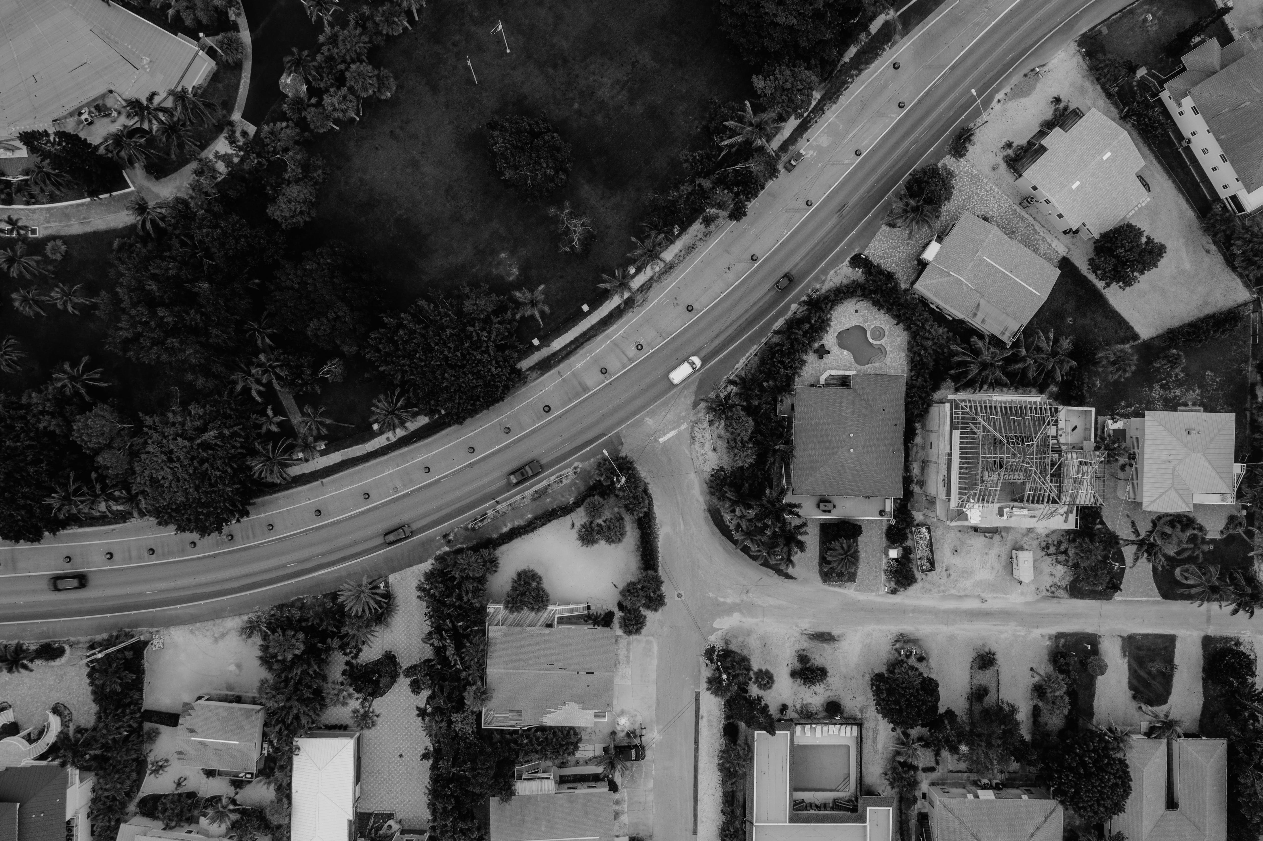Bird's-view and Grayscale Photography of Car on Street