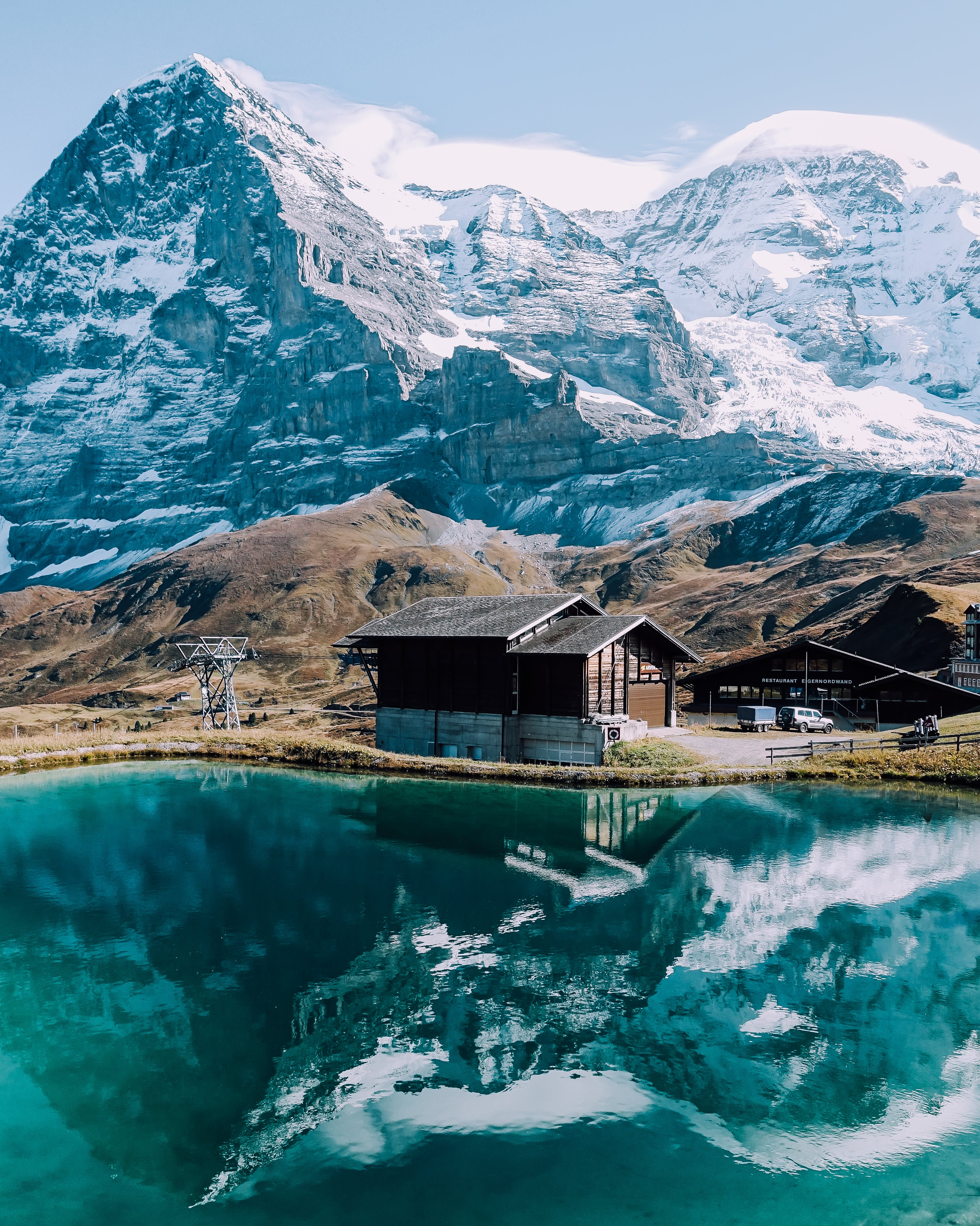 Brown Wooden House and Mountain Reflecting on Lake