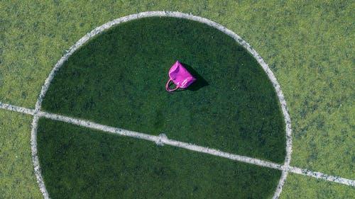 Pink Tote Bag On Football Field