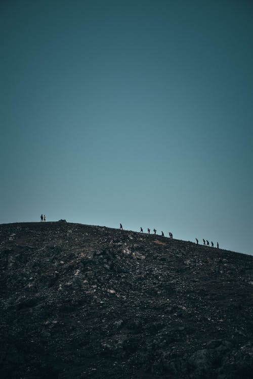 People Walking on Mountain