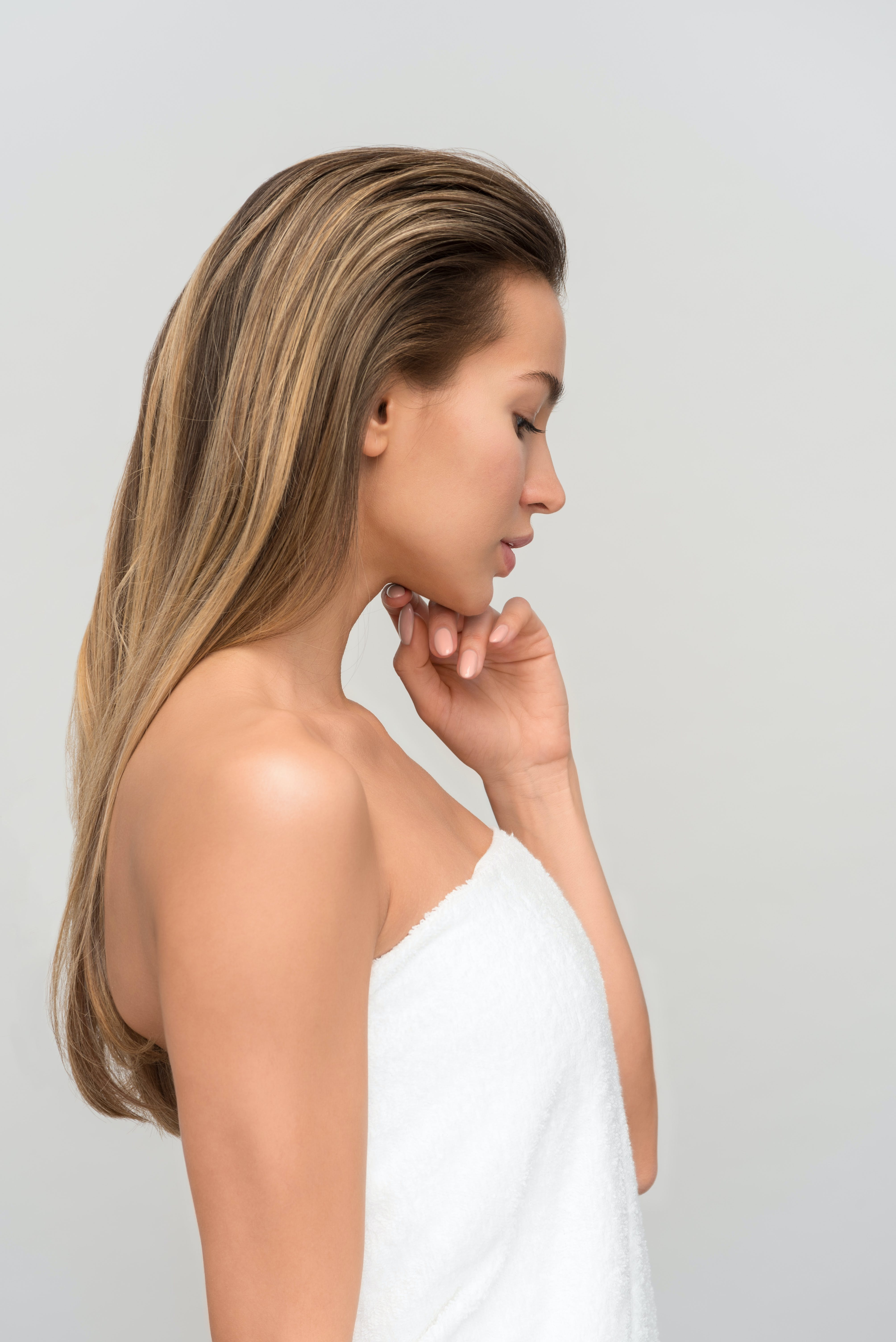 Female Standing With Left Hand on Chin