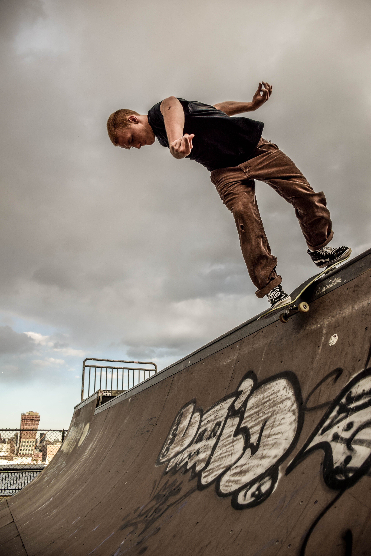 Man Riding Skateboard While Performing Stunts
