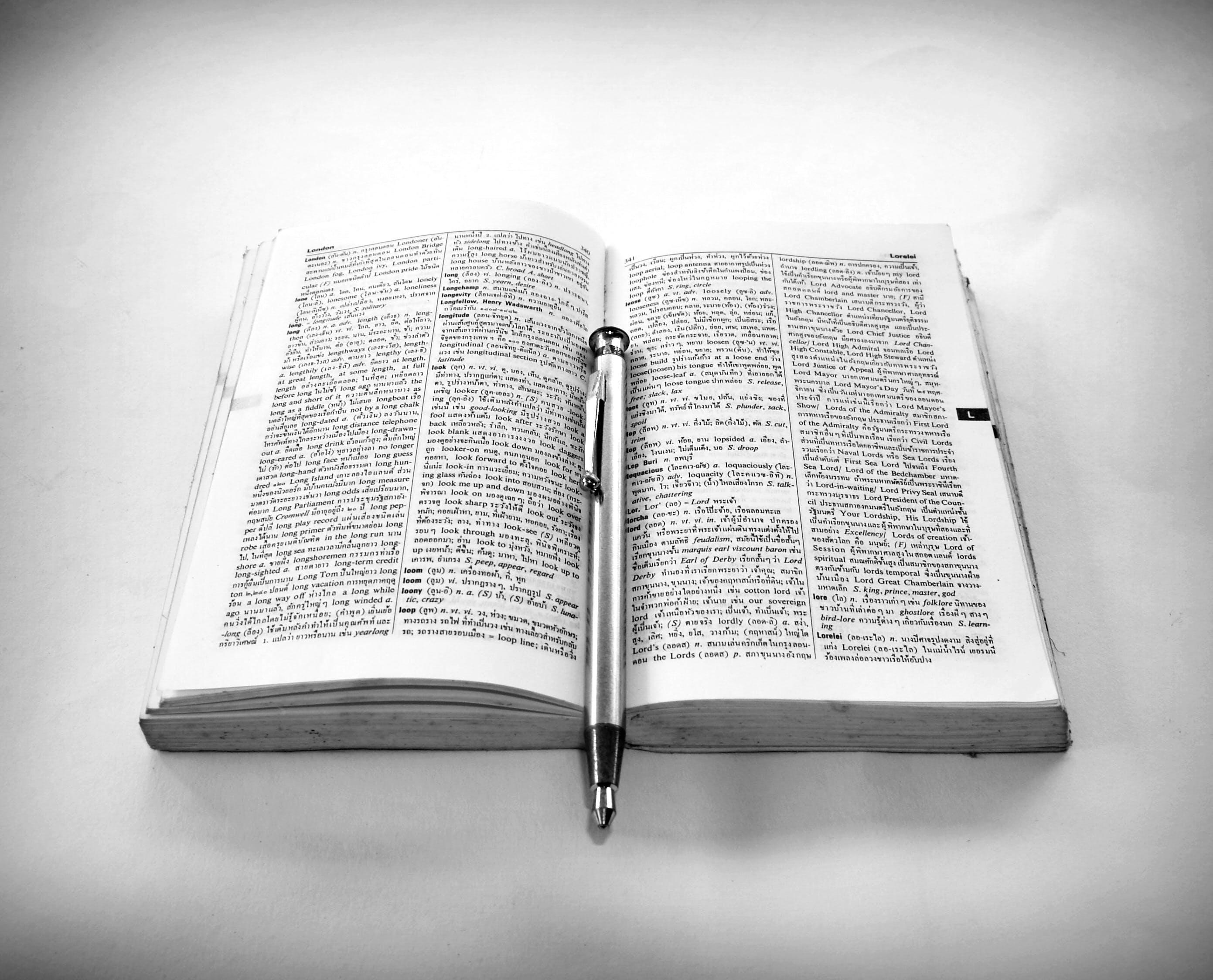 Book and Silver Click Pen
