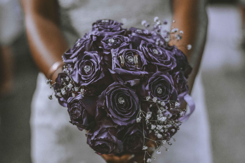 Bride Holding Bouquet of Purple Flowers