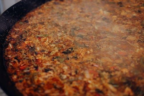 Gratis stockfoto met eten, paella, rijst