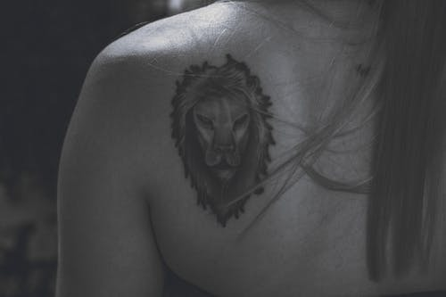 Lion's Tattoo on Woman's Back