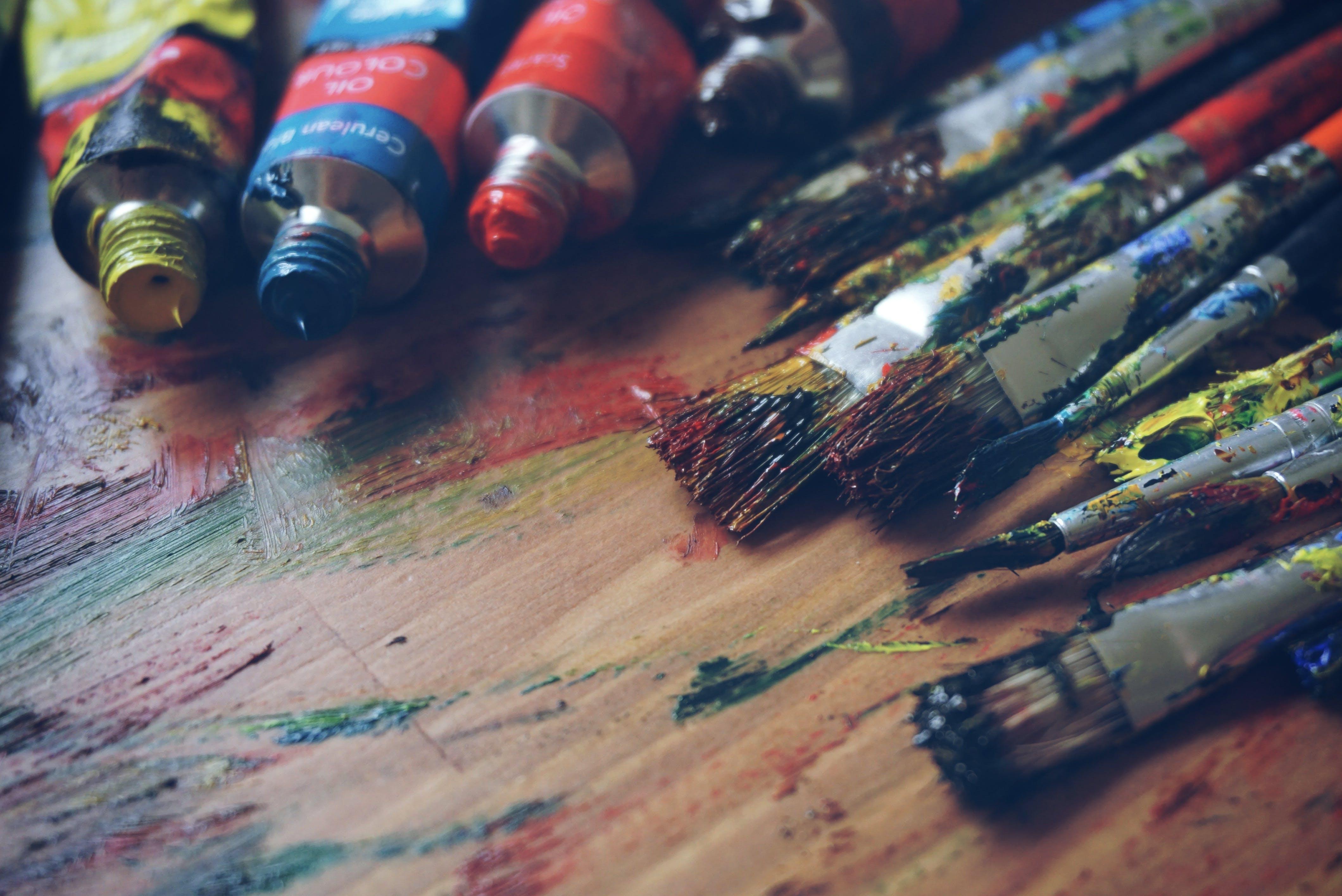 Paintbrushes Acrylic Paints on Wooden Surface