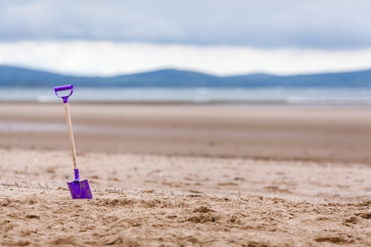 Purple Shovel on Sand Bottom Focus Camera