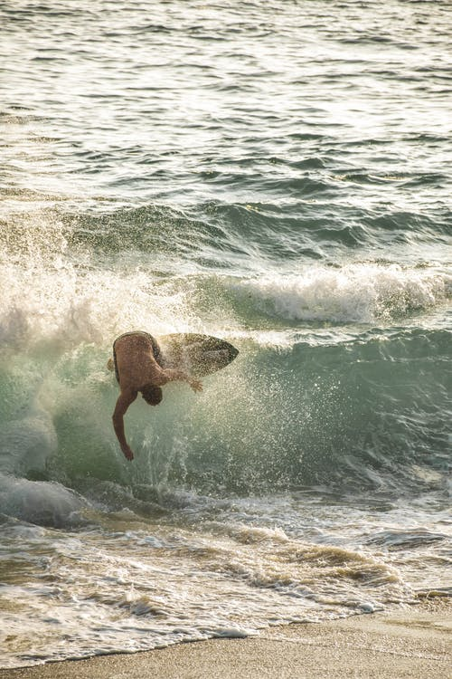 Photo of Man Surfboarding
