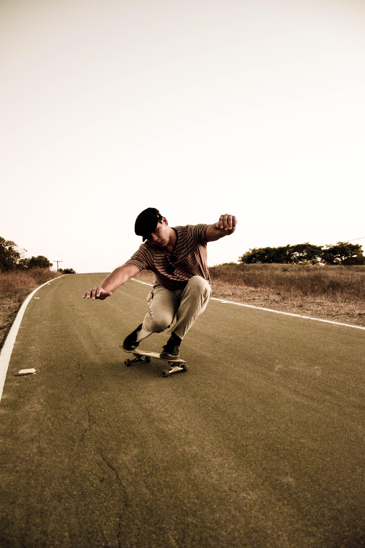 Photo of Man Riding Skateboard