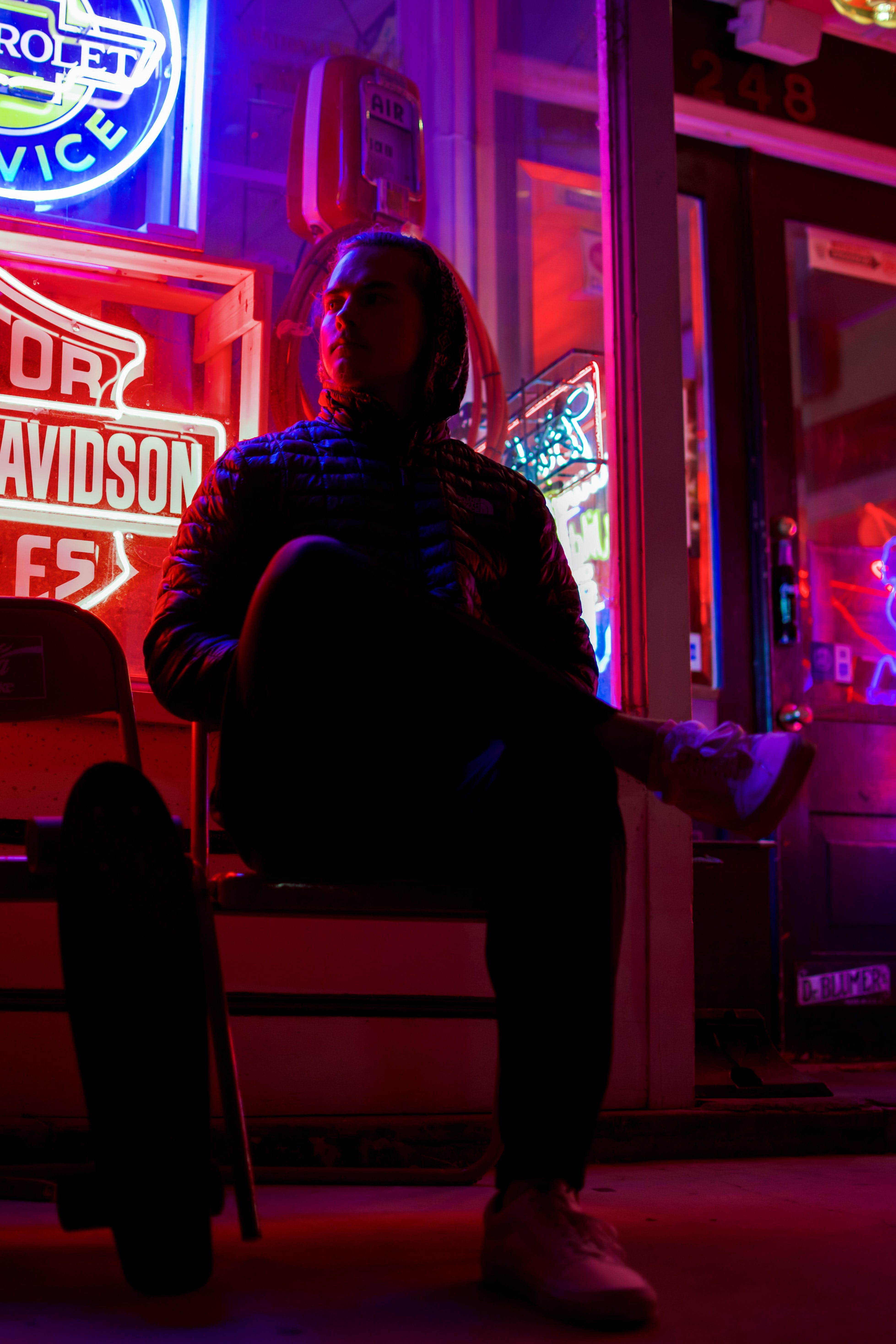 Man Sitting on Chair Cross Leg