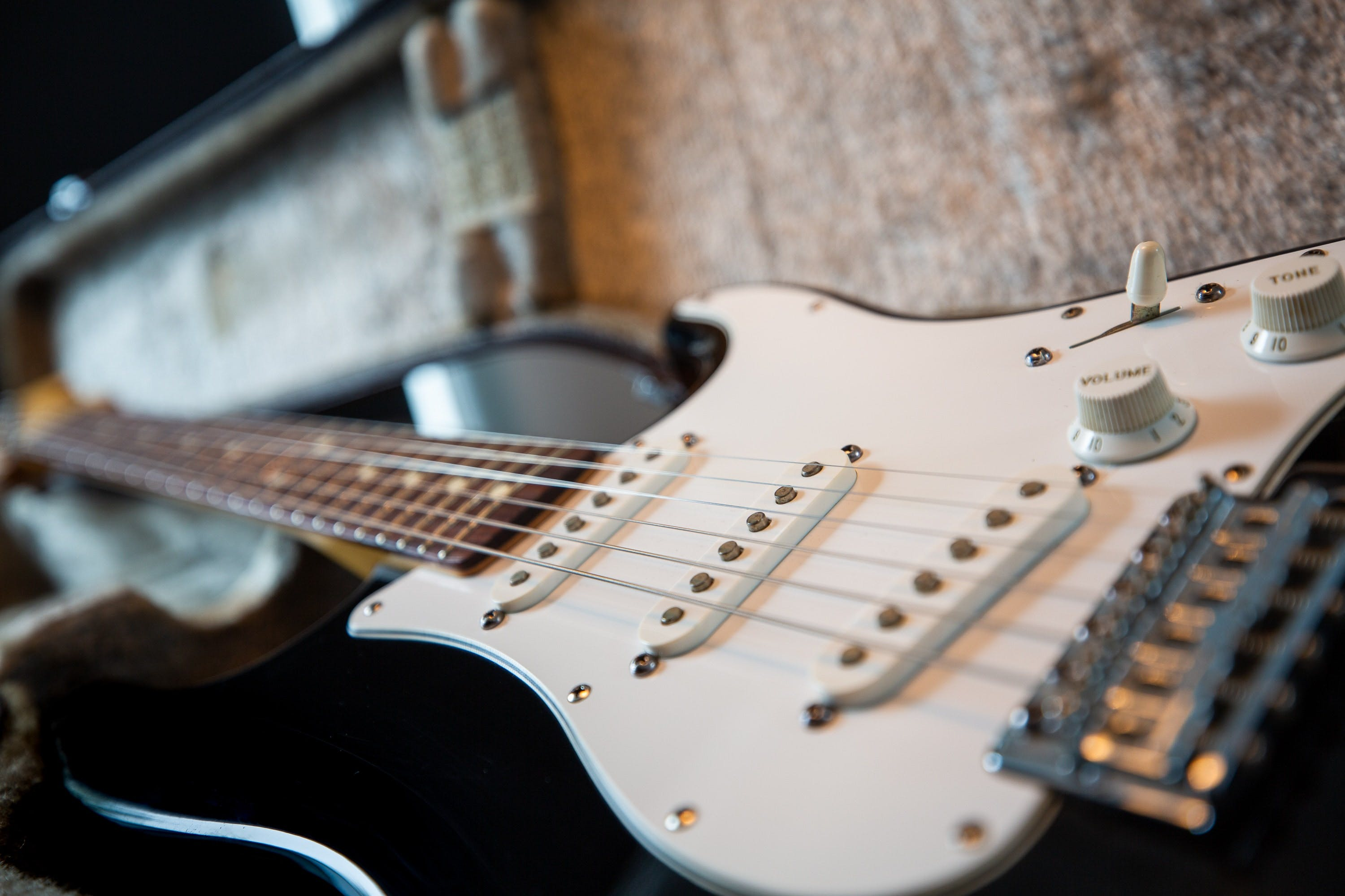 Selective Focus Photography of Black Electric Guitar