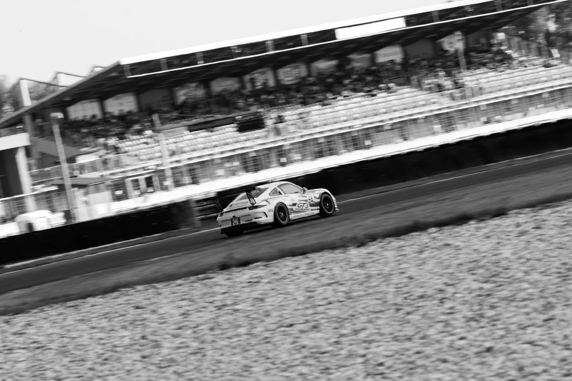 Grayscale Photo of Racing Car