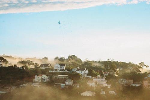 Foto profissional grátis de capa, casas, céu, céu limpo