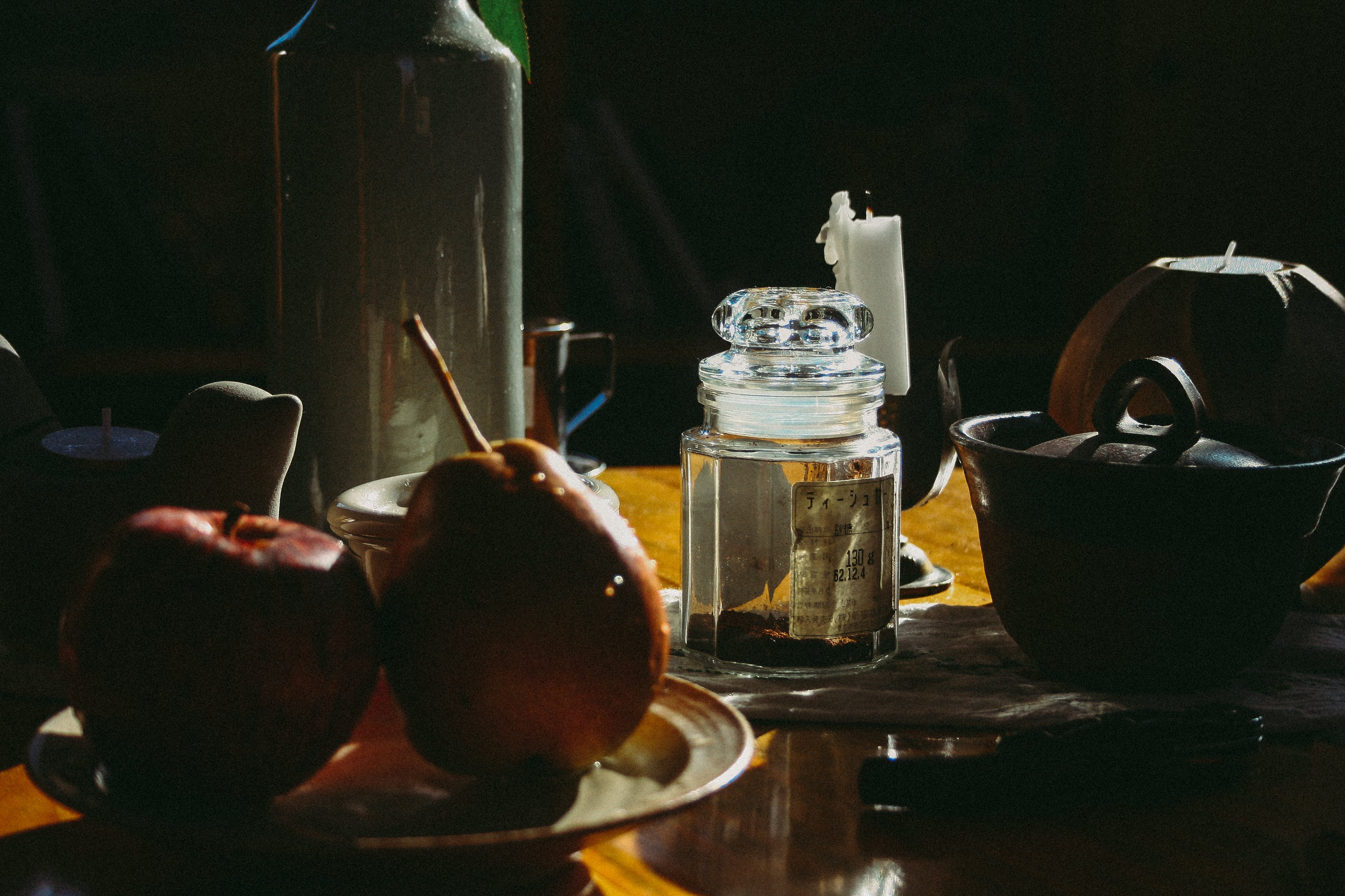 Apple and Pear Near Glass Bottle