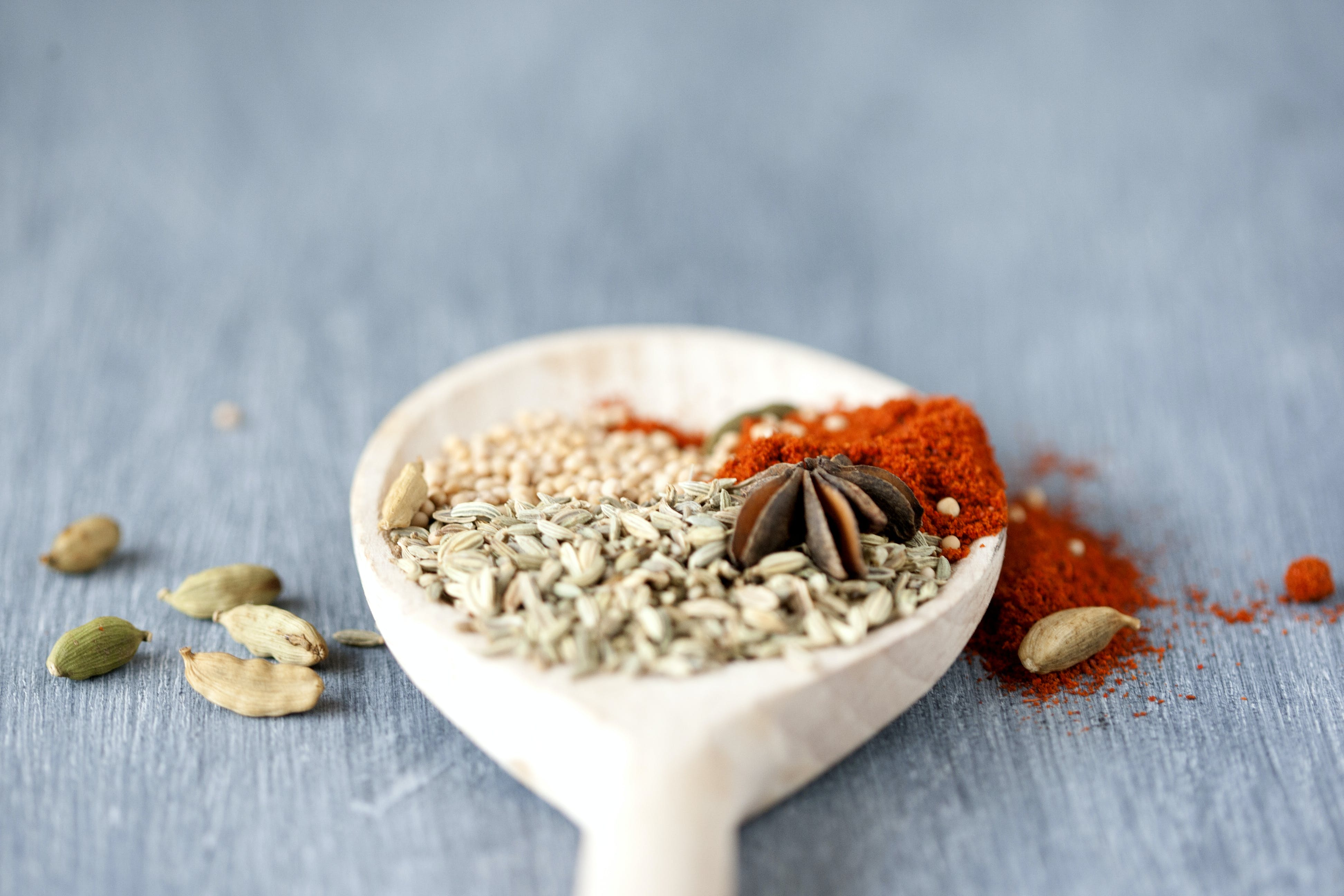 Assorted Seasoning in White Ceramic Spoon