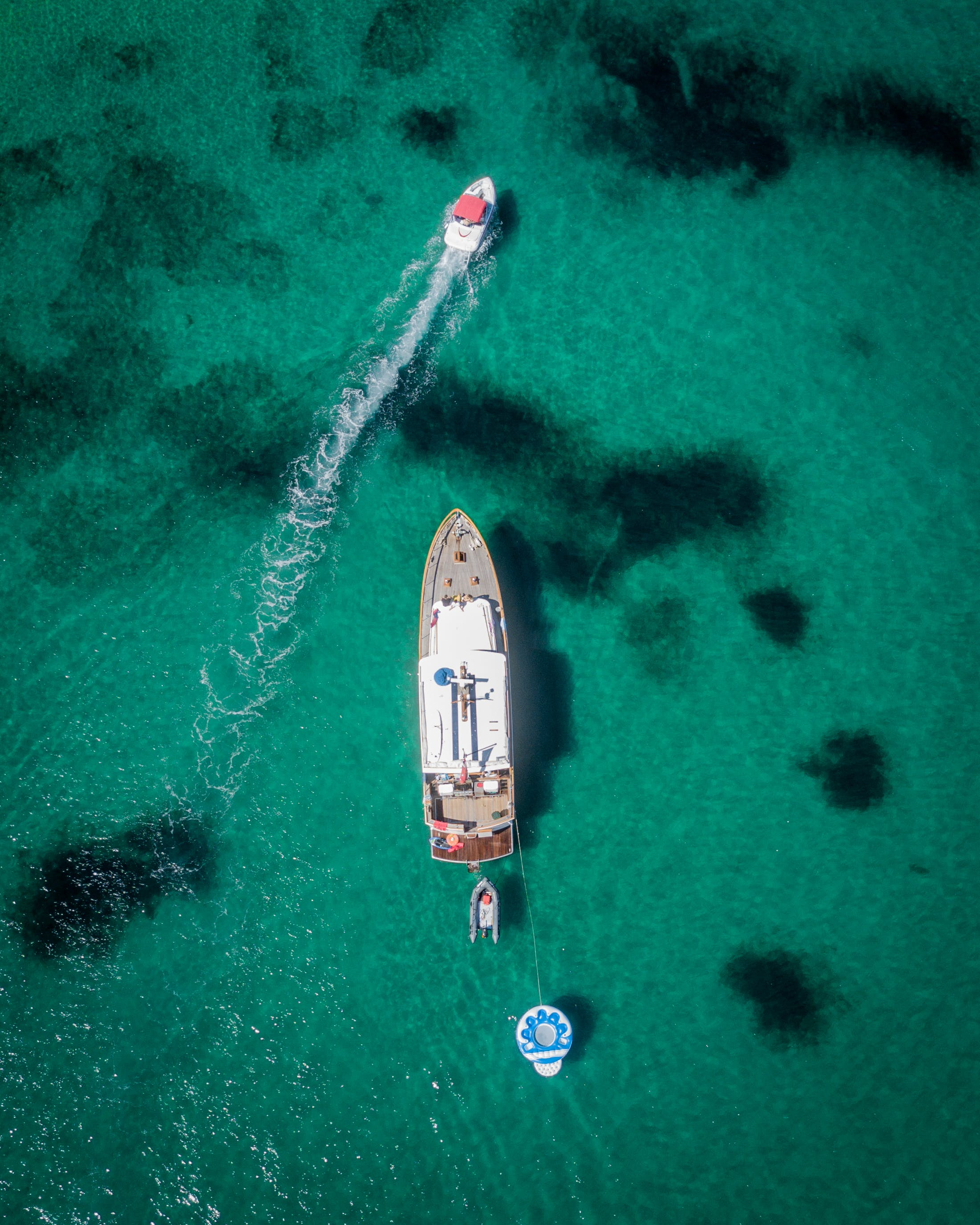 Aerial Photography of White and Brown Boat