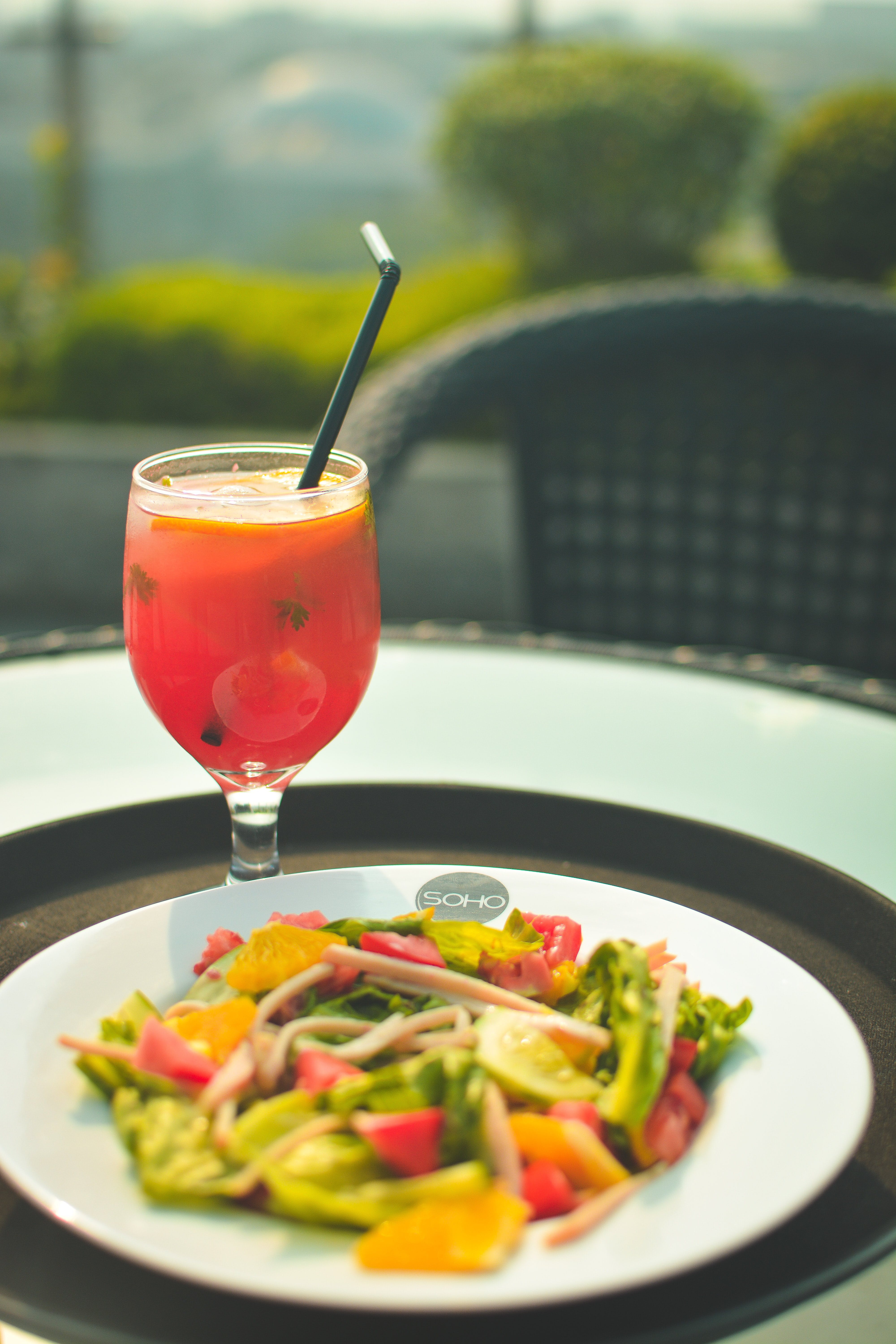 Drink Beside Salad on Black Tray