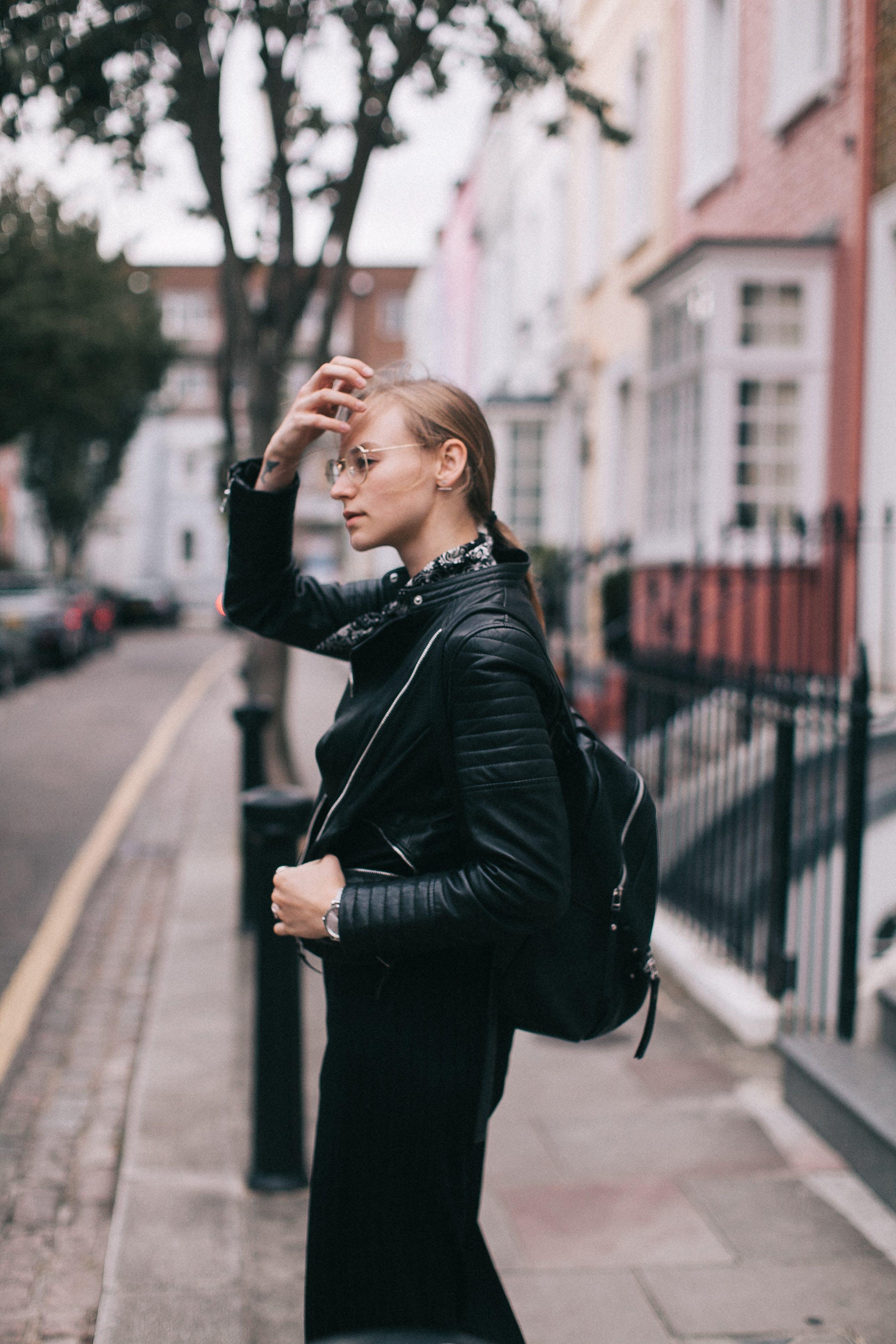 Woman Standing Beside Road