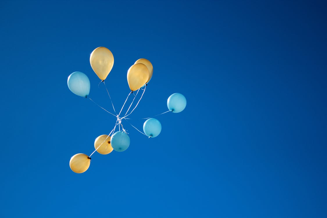 Photo of Yellow And Blue Balloons On Sky