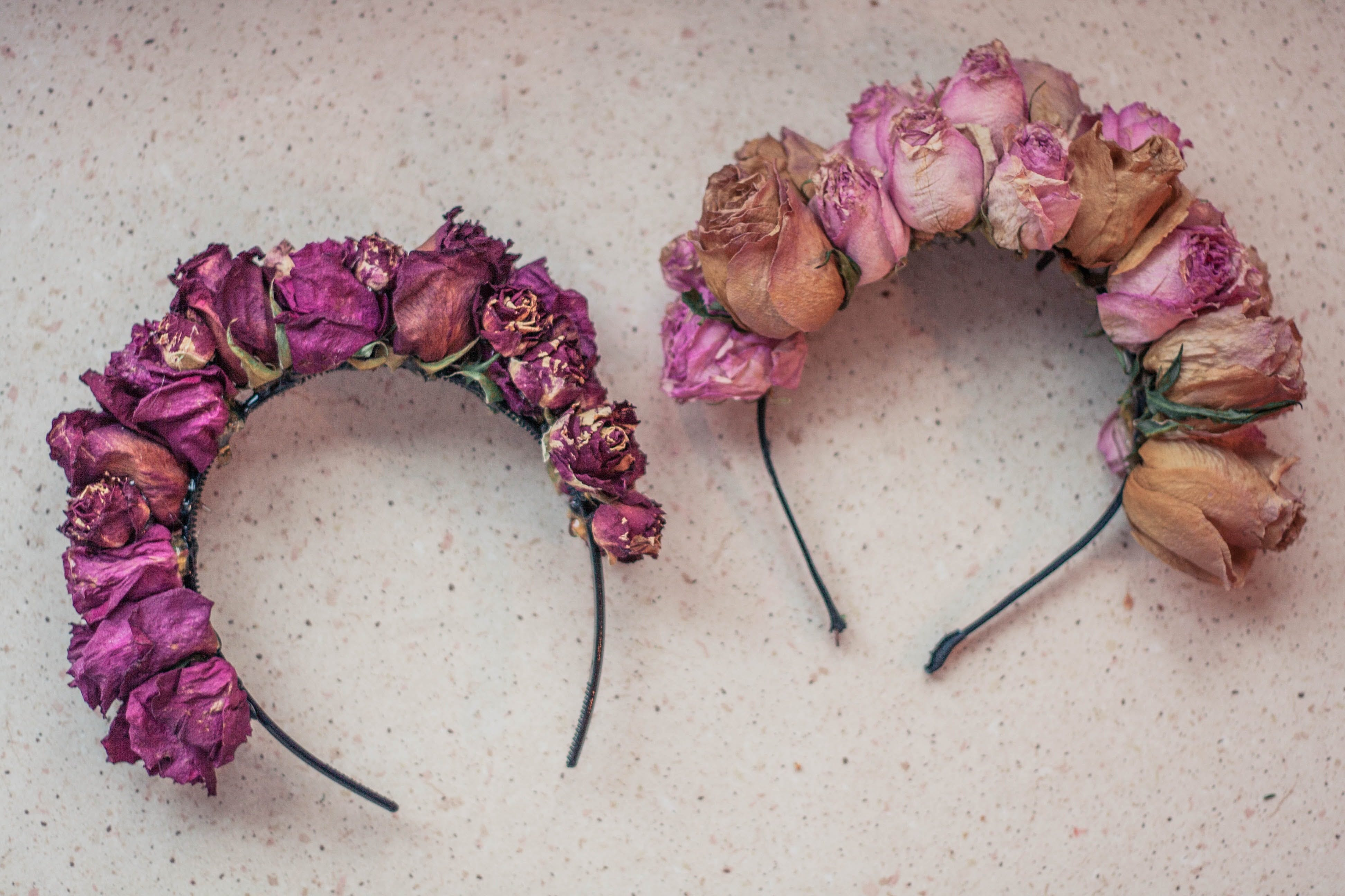 Two Pink Rose Flower-accent Headbands on White Surface