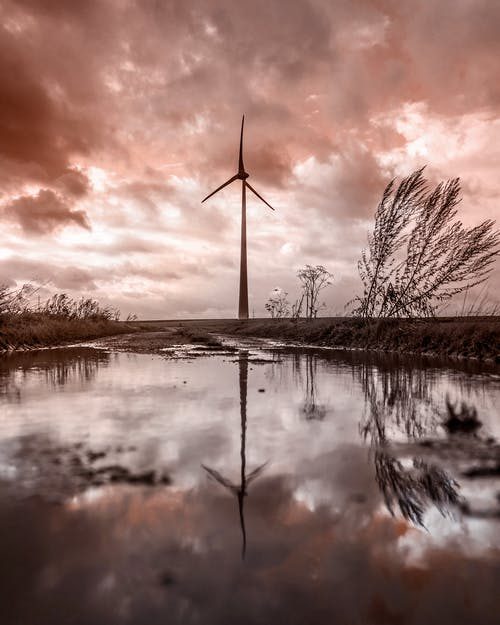 Windmill Near Body of Water
