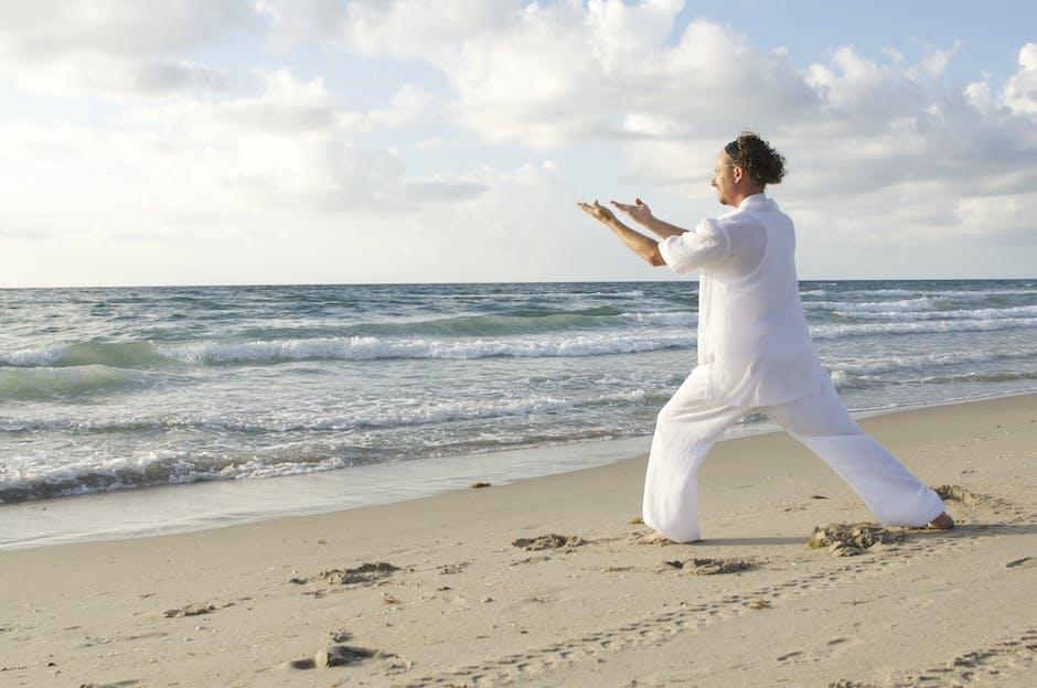 Man Posing on Sea Shore during Daytime