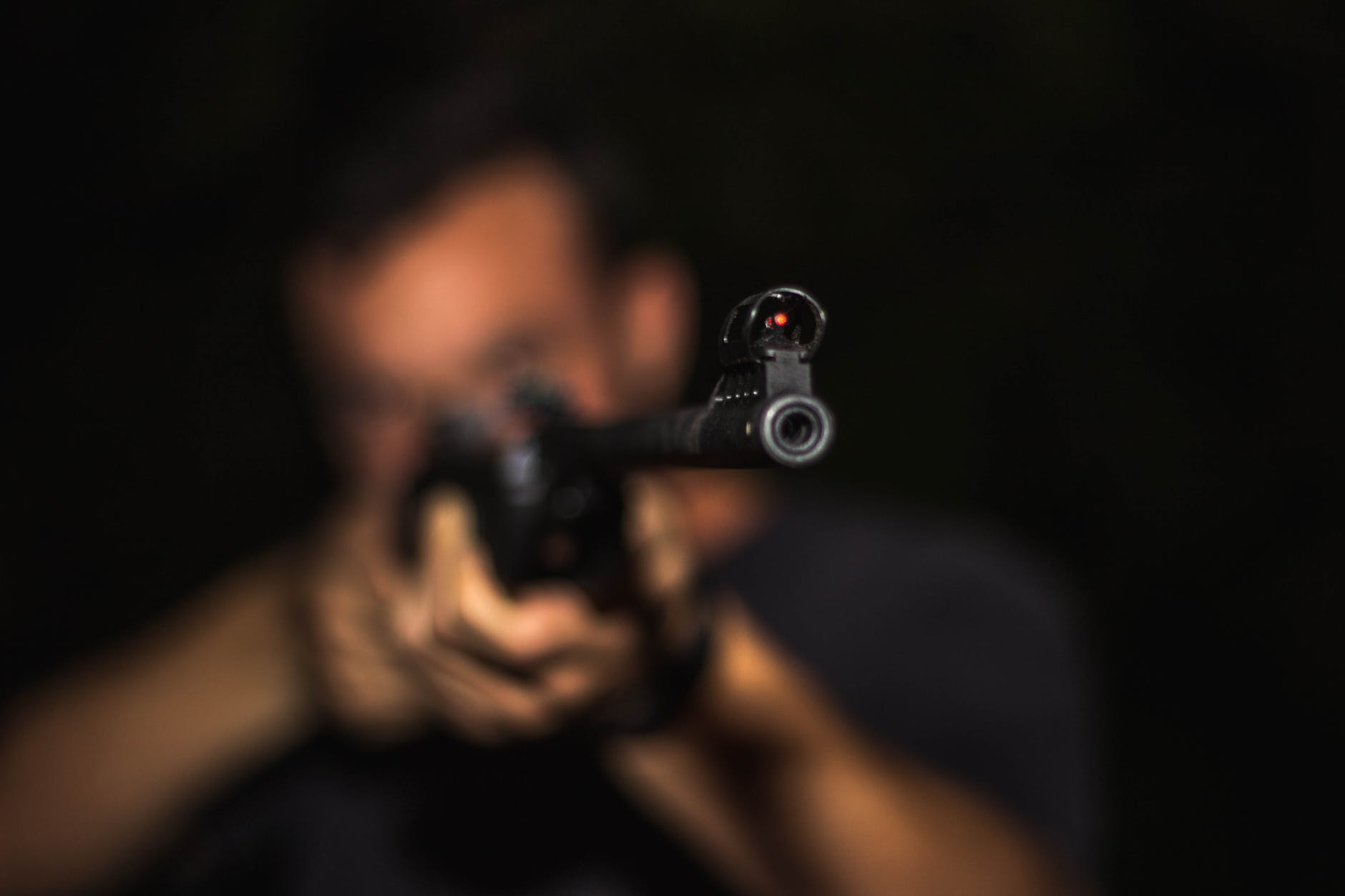 Person holding rifle