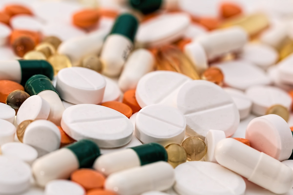Bunch Of White Oval Medication Tablets And White