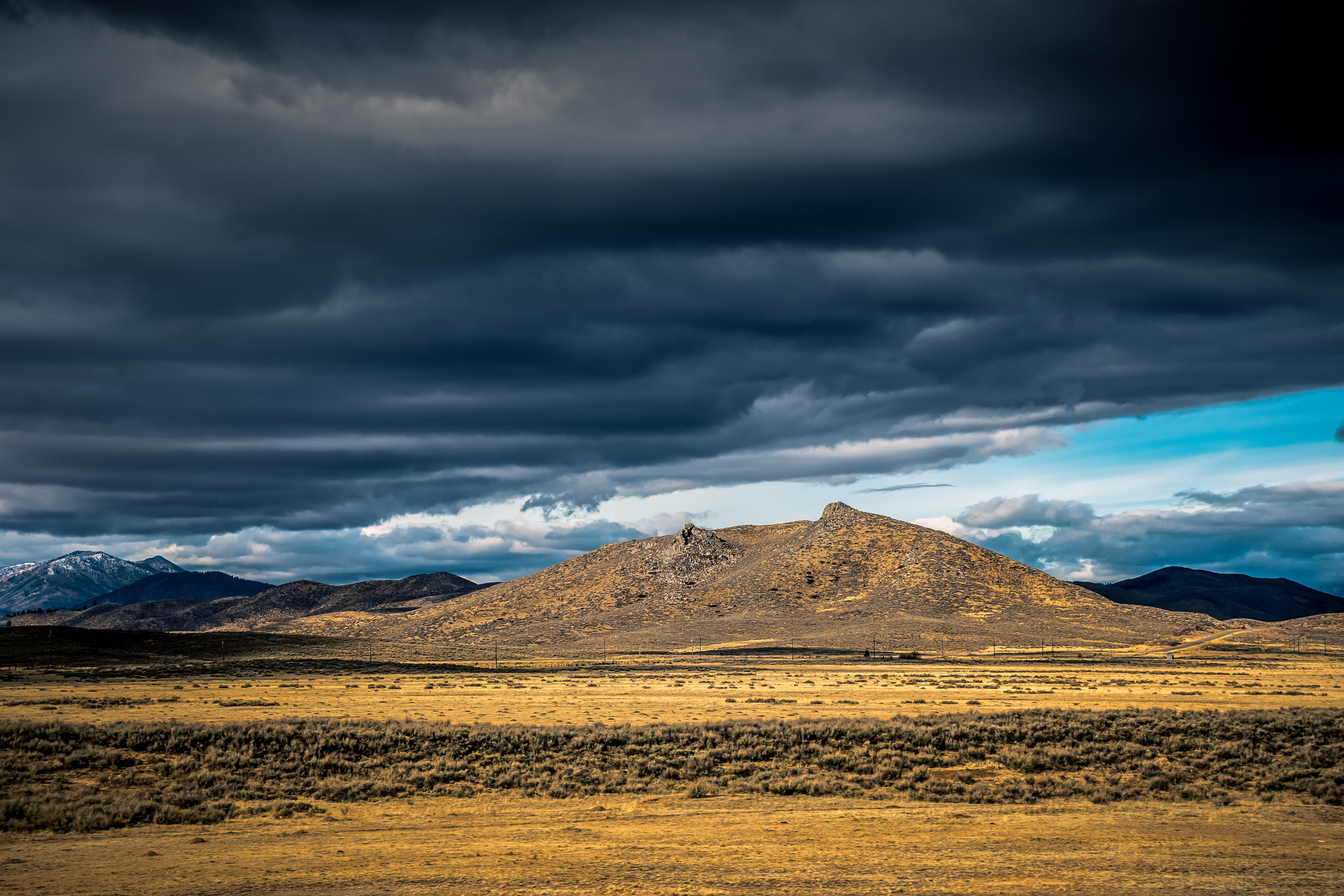Brown Mountain Under Gray Clouds
