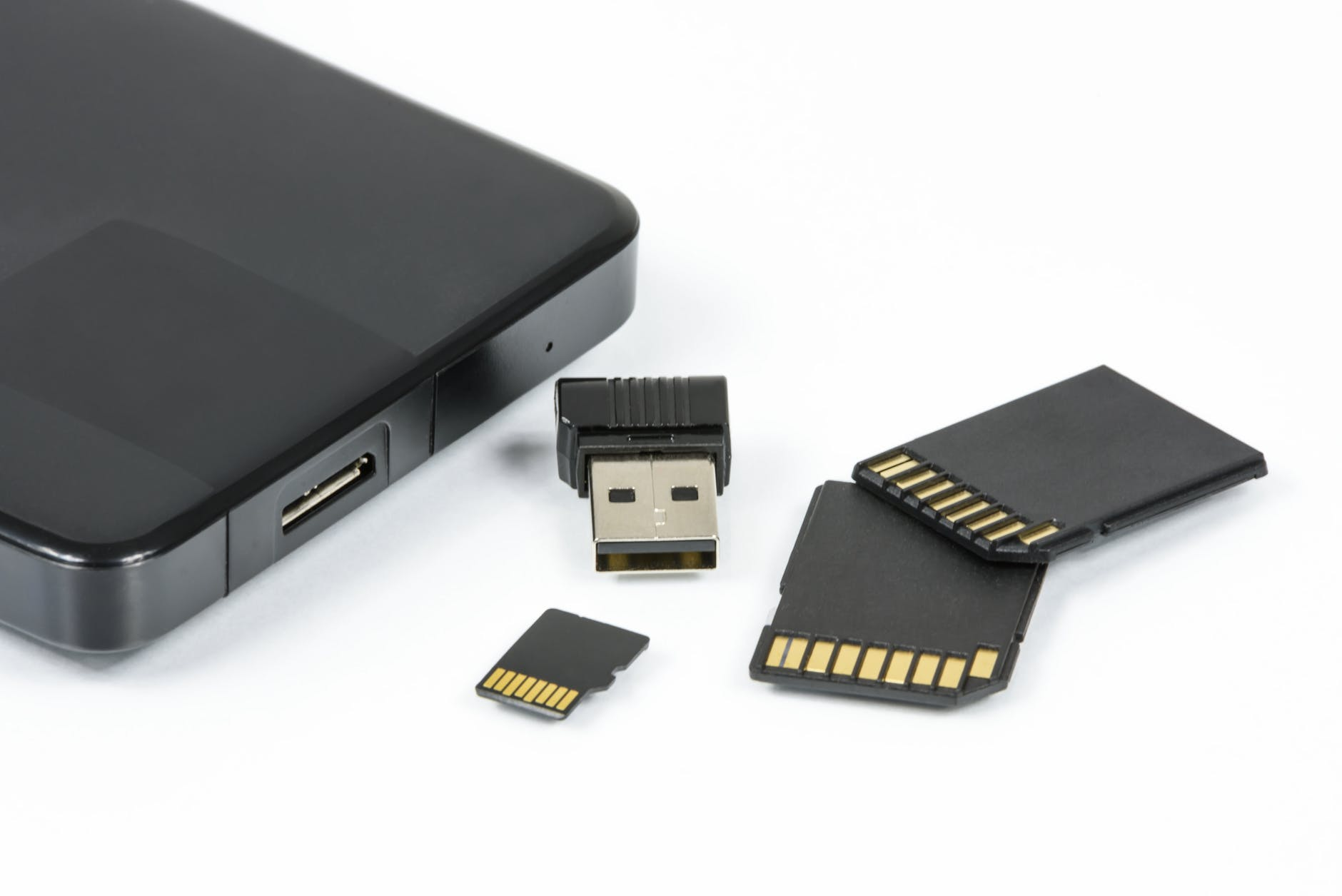 Black sd card near black android smartphone