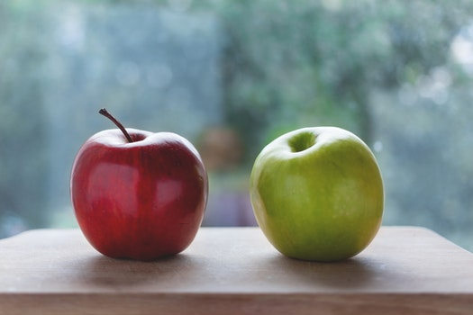 Red Apple Beside the Green Apple