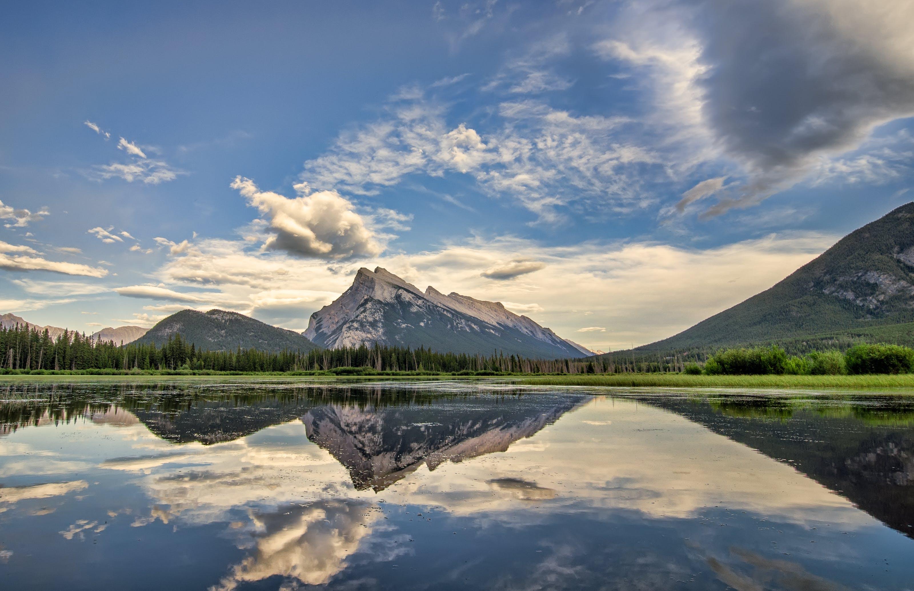 Body of Water Near Mountain Peaks