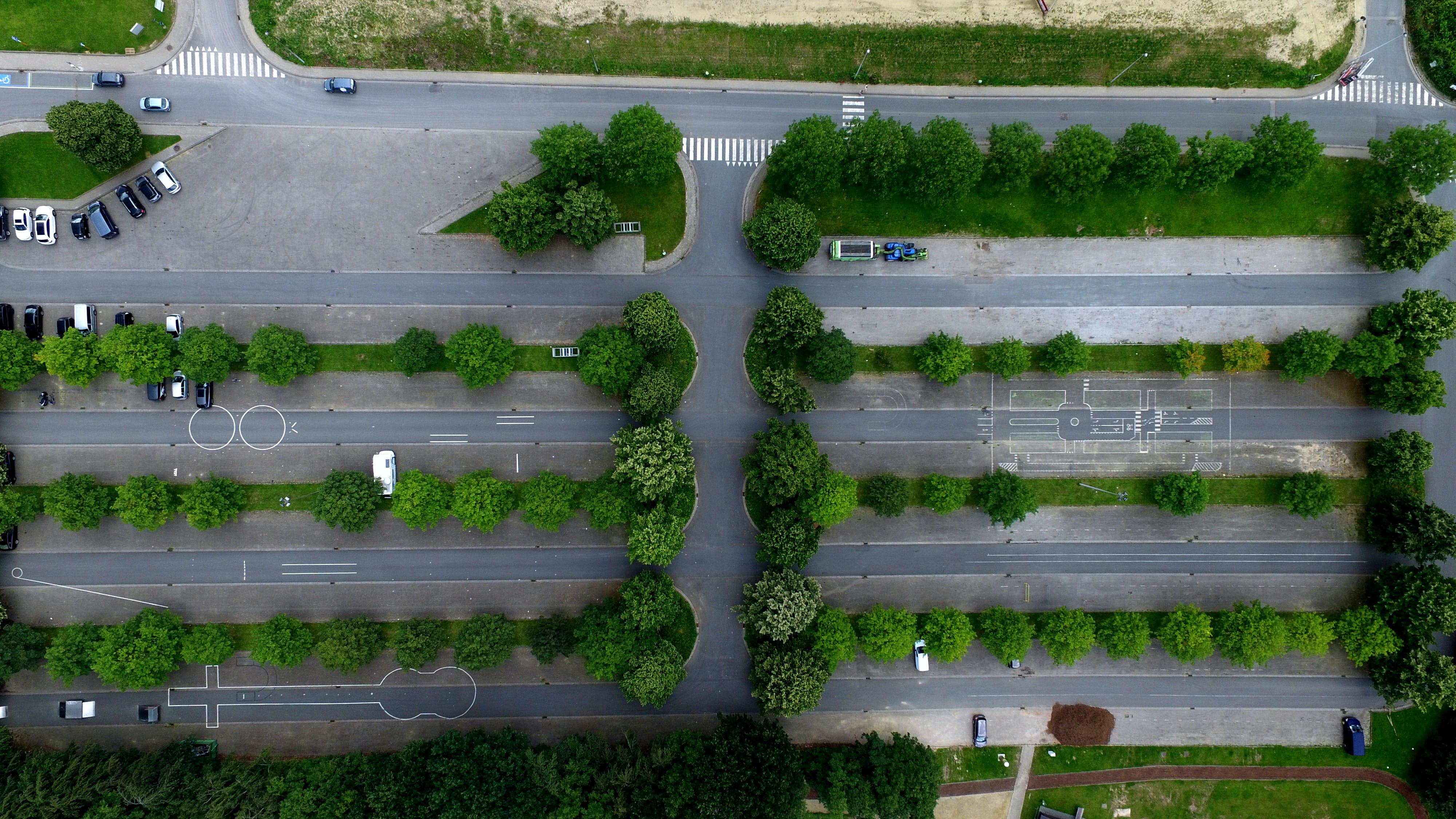 Aerial Photography of Parking Lot With Trees