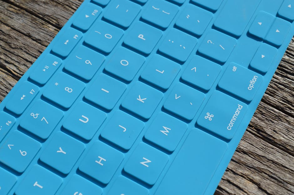 Blue Computer Keyboard On Gray Wooden Surface 183 Free Stock