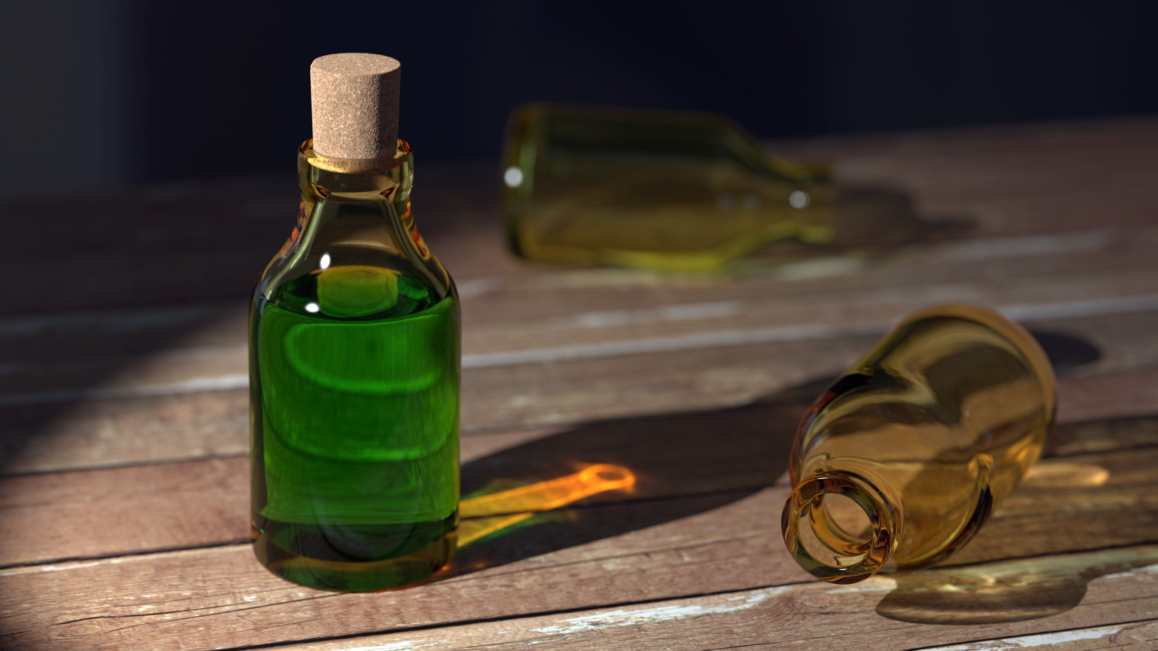 Green Liquid on Clear Glass Bottle With Cork
