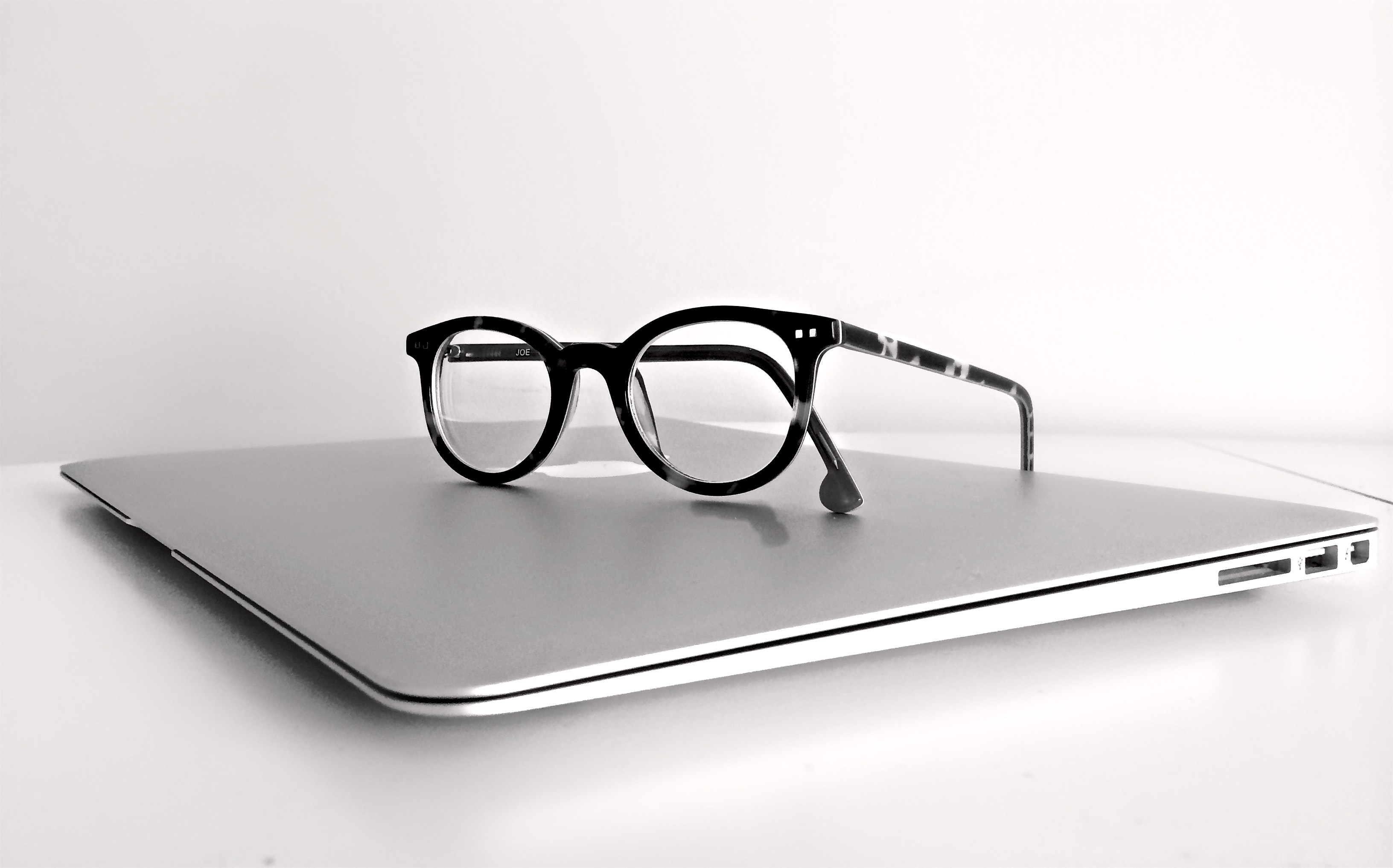 023ce30199 Black Frame Eyeglasses on Silver Macbook Air · Free Stock Photo