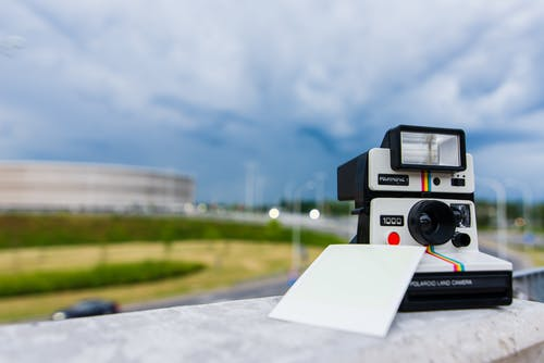 Black and White Polaroid Instant Camera With Photo Paper