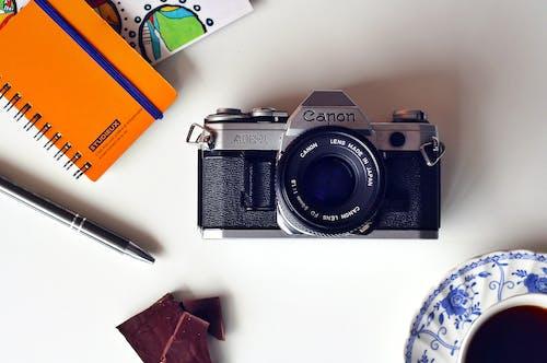 佳能, 咖啡, 攝影, 書桌 的 免费素材照片