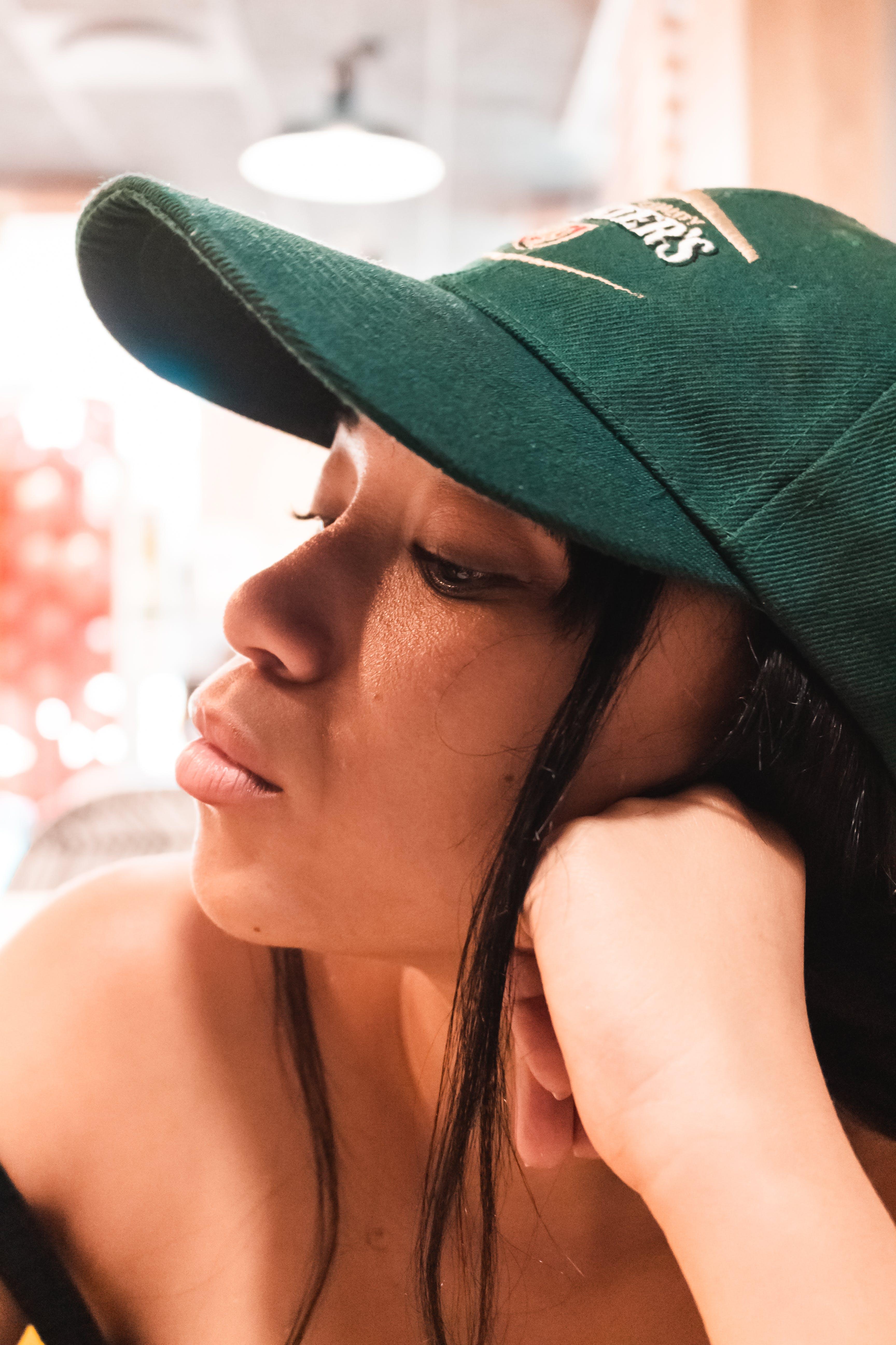 Close-up Photo Of Woman Wearing Cap