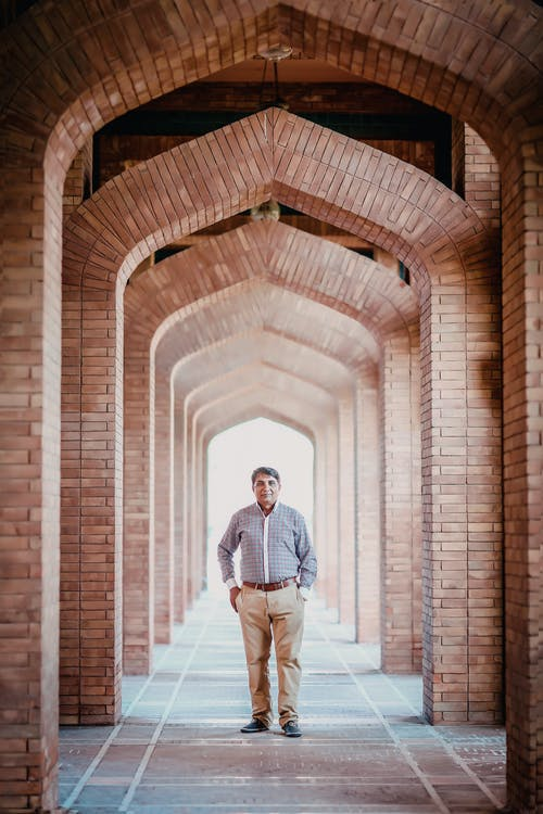 Man Standing in Concrete Arches