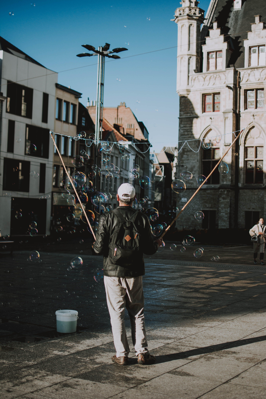Man in Black Top Making Bubbles