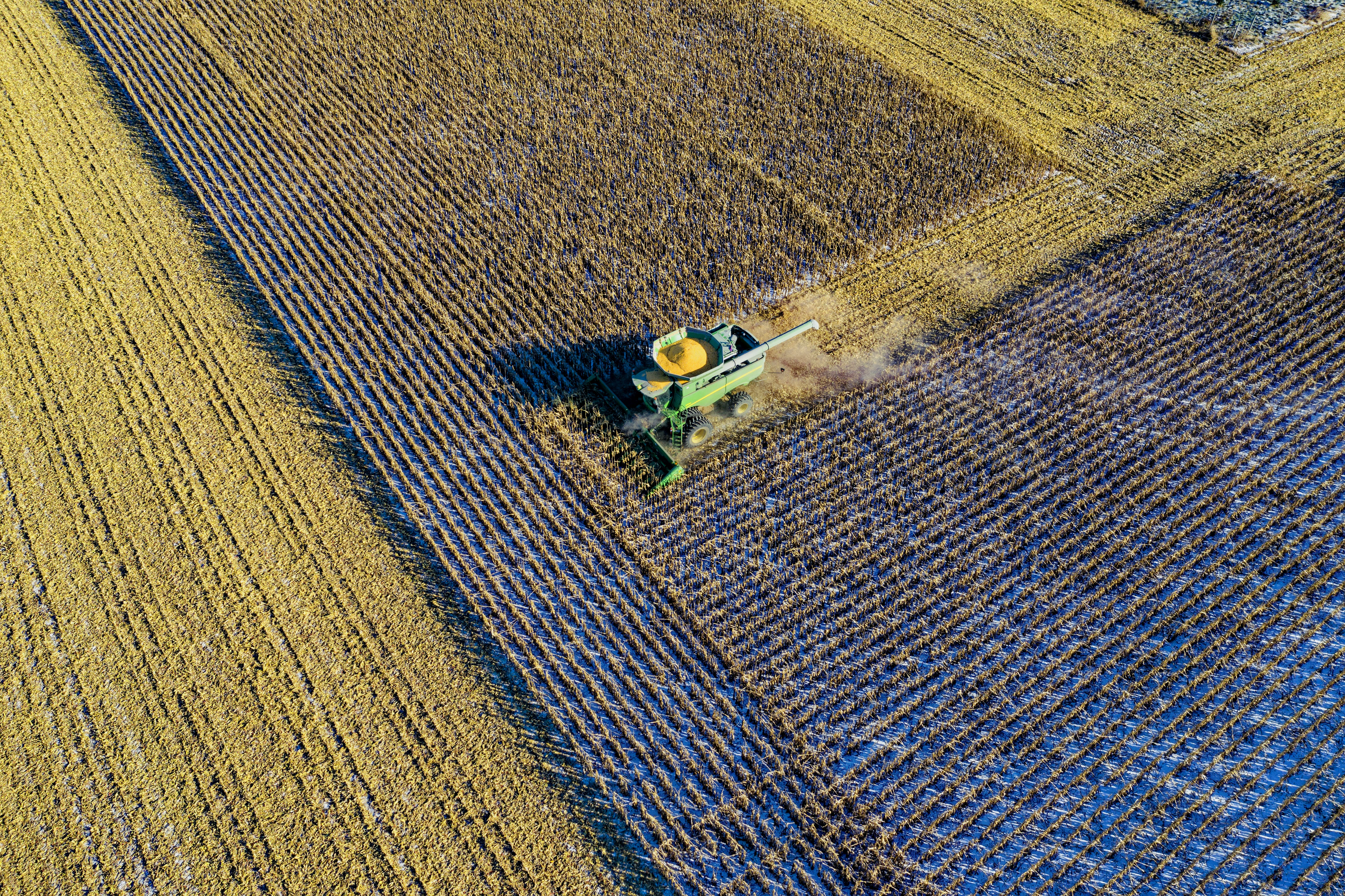 Aerial Photo of Green Milling Truck on Field Harvesting Crops