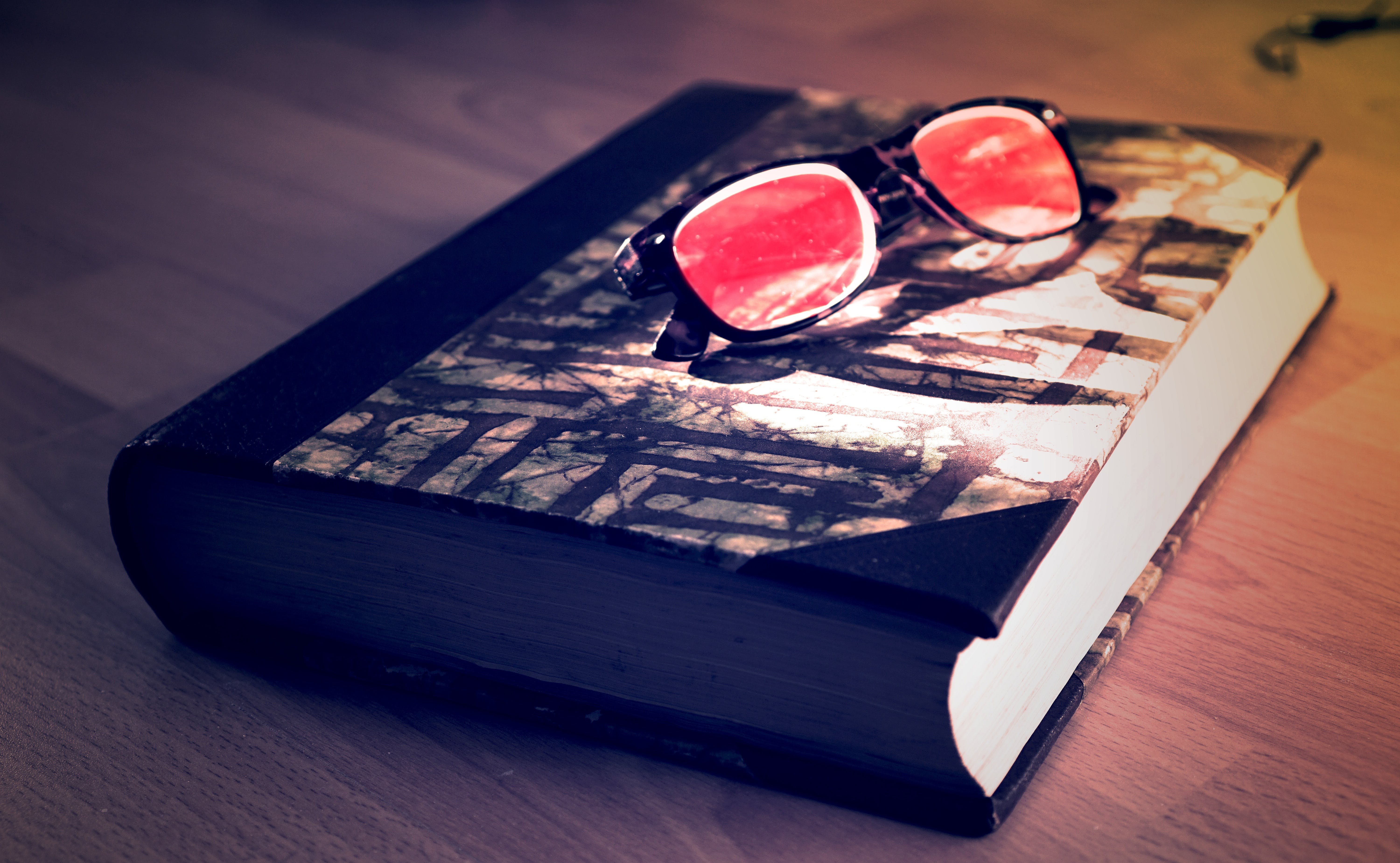 Black Framed Sunglasses on Black Book