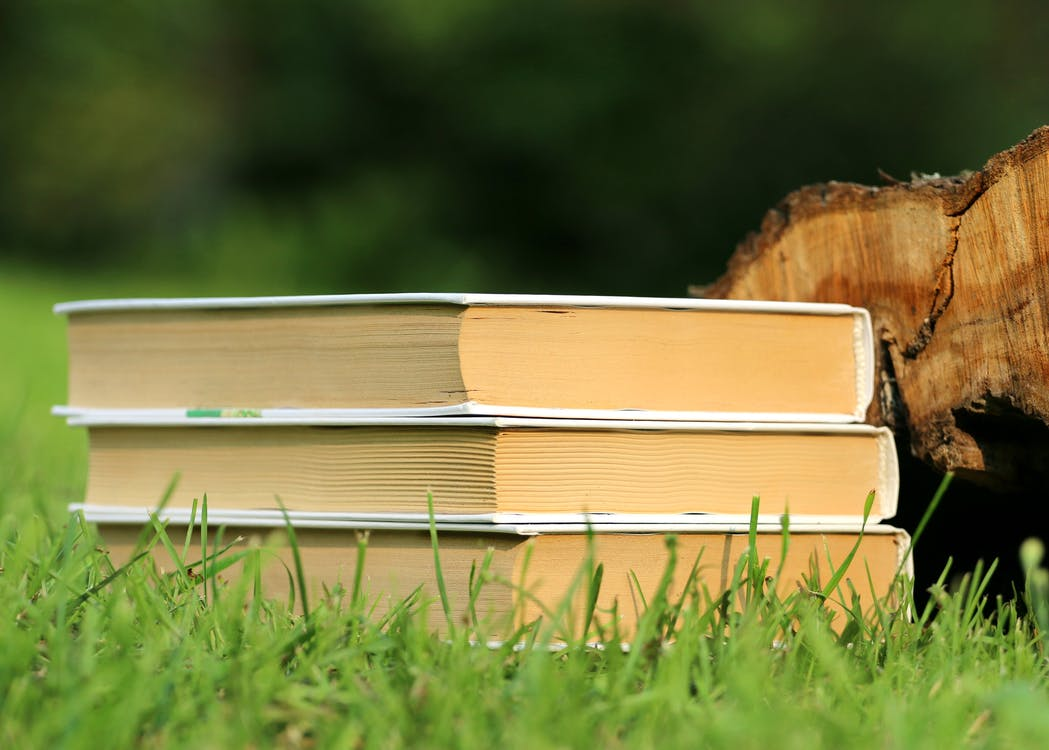 Selective Focus Photography of 3 Book Piled