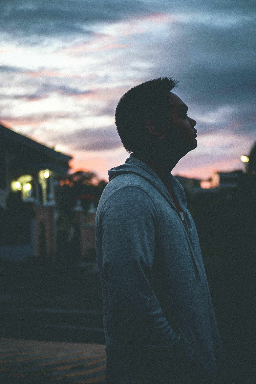 Silhouette of Man Wearing Hoodie
