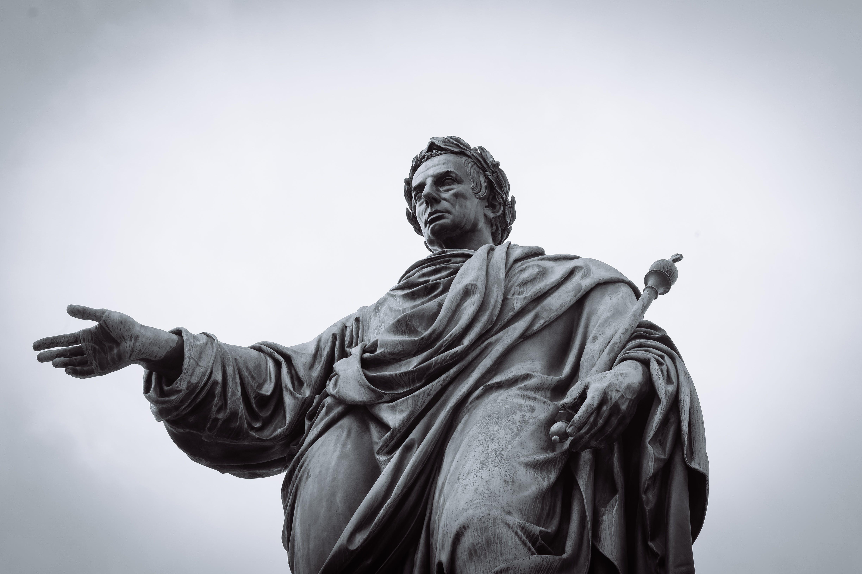 Man Holding Staff Statue