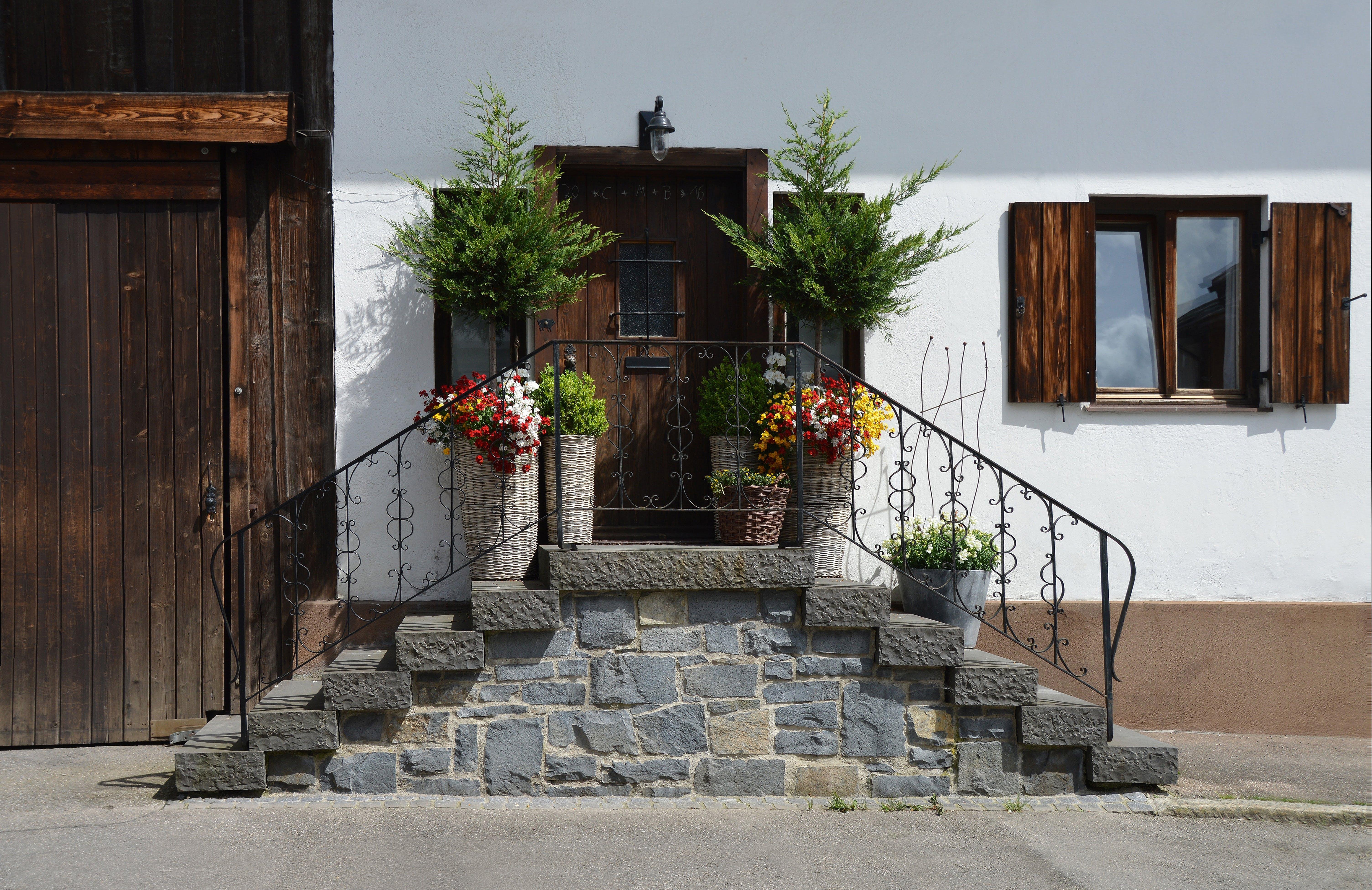 Brown Wooden Door in Front of Bricked Stairs