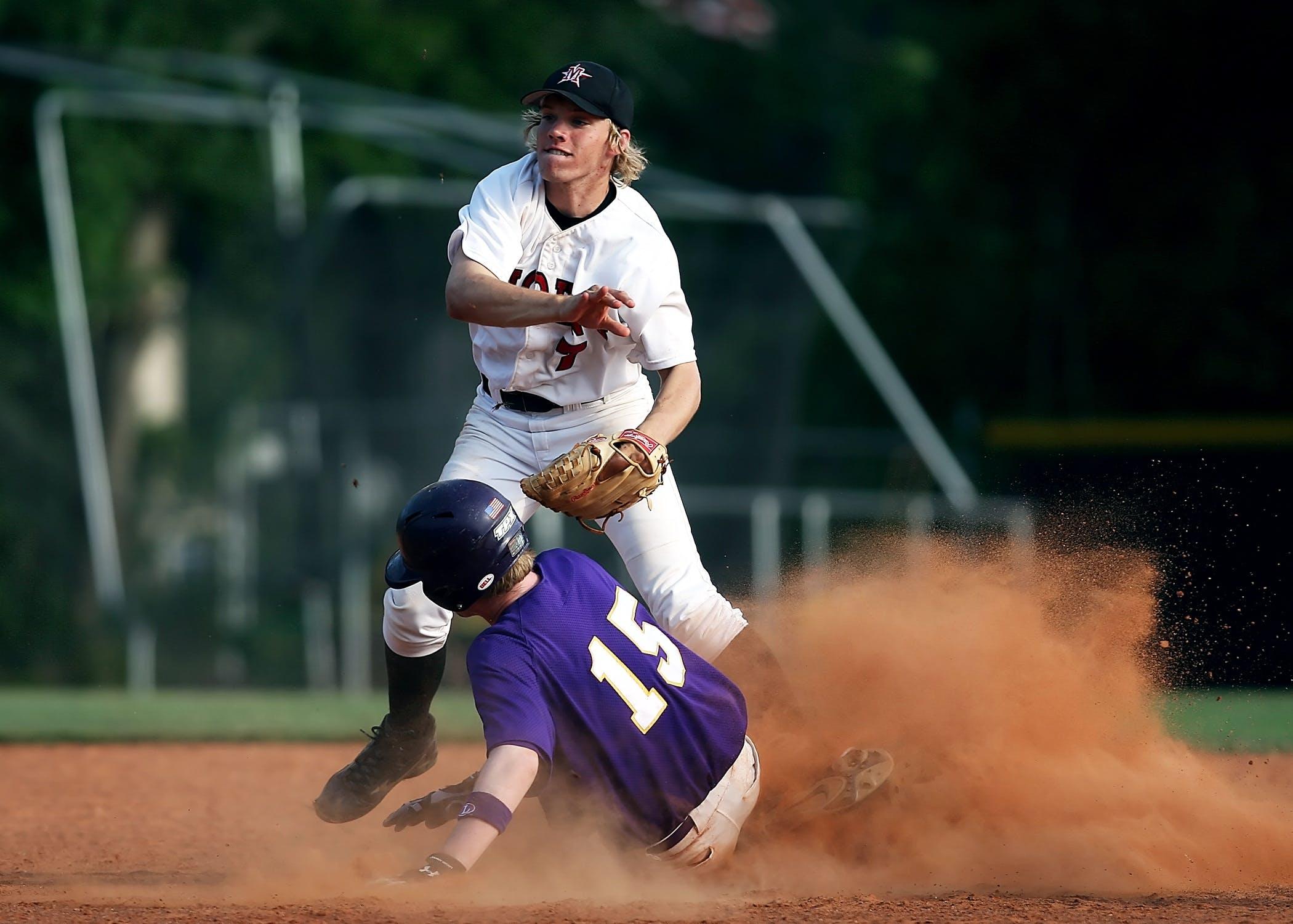 2 Man Playing Baseball on Brown Field