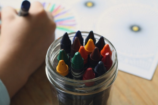 Multicolored Crayons Inside Clear Plastic Round Case